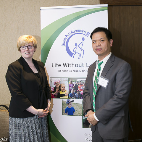 The Hon Carla Qualtrough, Minister of Sport and Persons with Disabilities, (left) and Andy Yu, CPABC President (right).